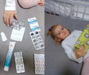 Co všechno by mělo být v lékárničce v kočárku a dítě, jak ji drží.